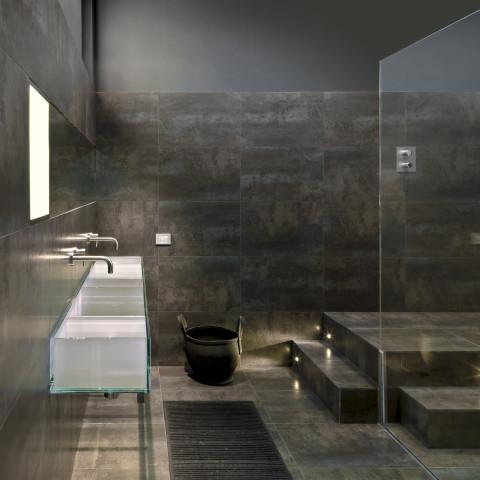 detail of a glass washbasin in a modern bathroom