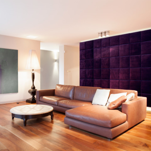 Leather couch in new modern lounge with wooden parquet
